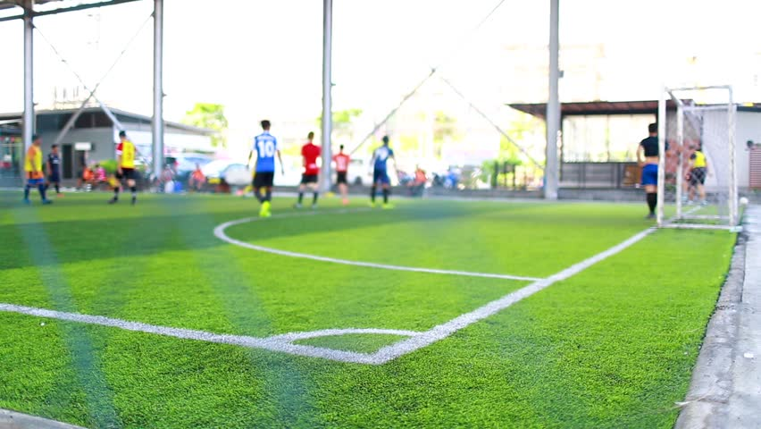 The corner of football field with blurry players background, corner for corner kick with blurry soccer players, soccer training or football match. | Shutterstock HD Video #1029029645
