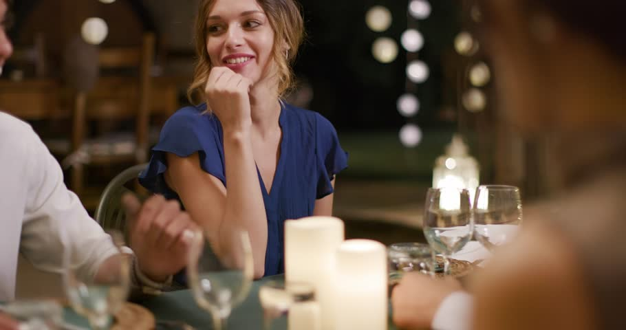 Four people, two couples happy talking and eating during a romantic gourmet dinner or lunch.Medium shot. Friends italian trip in Umbria.4k slow motion | Shutterstock HD Video #1029075065