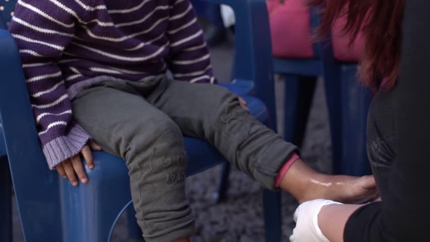 Cucuta/Venezuela - May 1, 2019: Venezuelan migrant girl gets feet rinsed | Shutterstock HD Video #1029136865