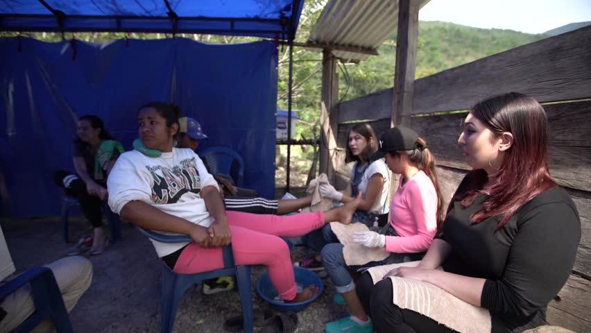 Cucuta/Venezuela - May 1, 2019: Venezuelan migrants get feet dried | Shutterstock HD Video #1029136895