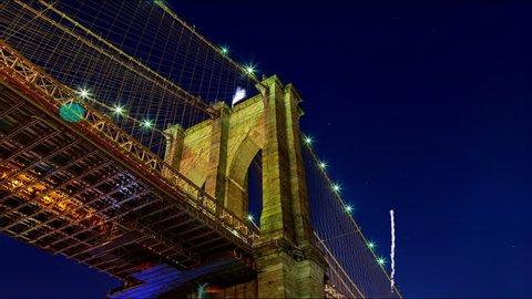 Amazing sparkling fireworks Brooklyn Bridge at dusk from New York City.