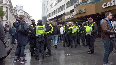 LEICESTER SQUARE, LONDON - MAY 9, 2019: Police monitor football fans before the Chelsea vs Eintracht Frankfurt game in Leicester Square, West End, London, UK.