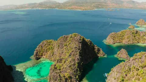 Aerial drone lagoons and coves with blue water among the rocks. lagoon, Kayangan Lake.mountains covered with forests. Seascape, tropical landscape. Palawan, Philippines, Busuanga