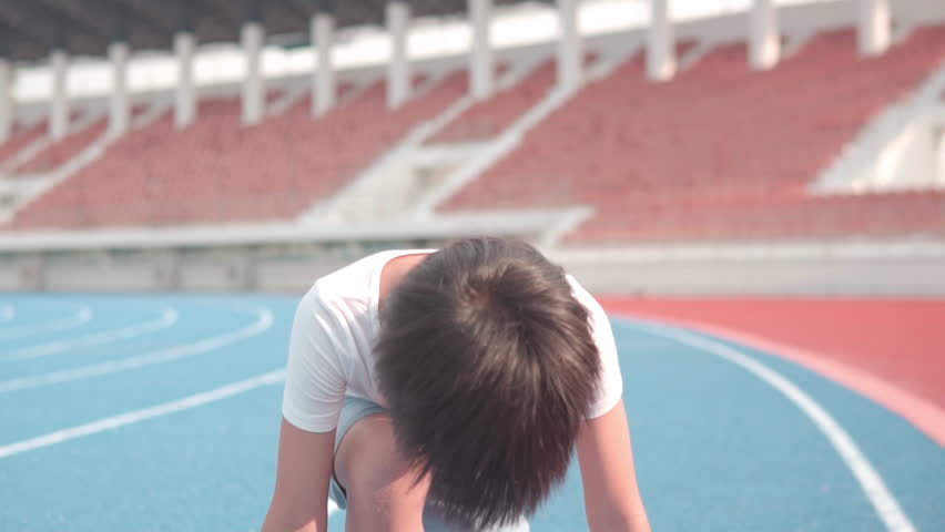 Close up of slow motion of young Asian boy run on a blue track in summer   Shutterstock HD Video #1029291455