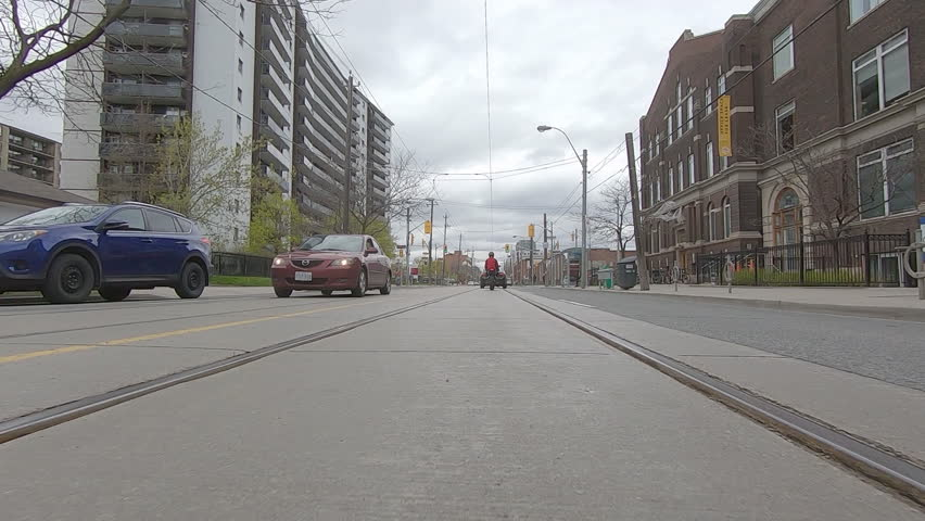 Toronto, Ontario, Canada May 2019 POV driving low angle city of Toronto streets with cars and transit vehicles | Shutterstock HD Video #1029324545