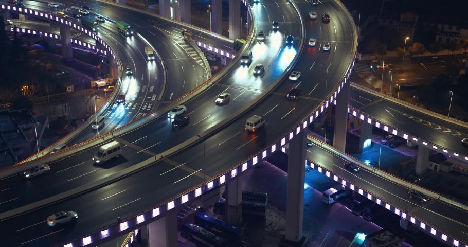 Car traffic moving on multi row Spiral Nanpu bridge in the evening, Shanghai | Shutterstock HD Video #1029325505