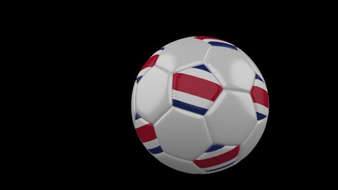 Soccer ball with the flag of Costa Rica flies past the camera, slow motion, 4k footage with alpha channel