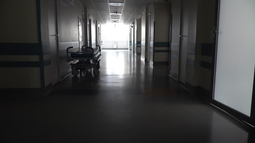 Dark Long Hallway with the Medical Gurney in the Hospital