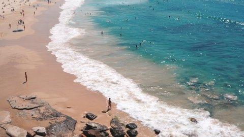 People relaxing and sunbathing at Bondi beach in Sydney, Australia