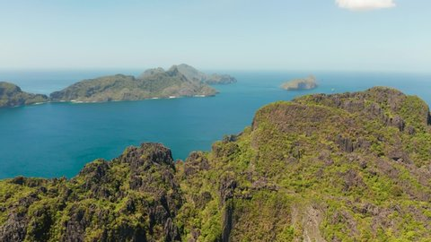aerial view of bay and the tropical islands. Seascape with tropical rocky islands, ocean blue water. islands and mountains covered with tropical forest. El nido, Philippines, Palawan. Tropical