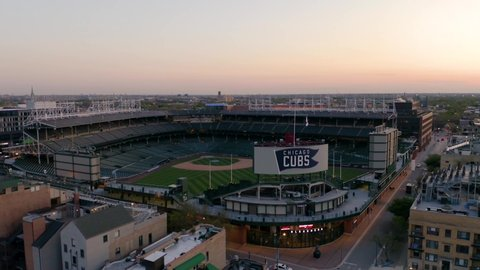 Chicago, Illinois / USA - May 13 2019: Fixed Wing Shot of Wrigley Field During Sunset - Home of the Chicago Cubs [4K]