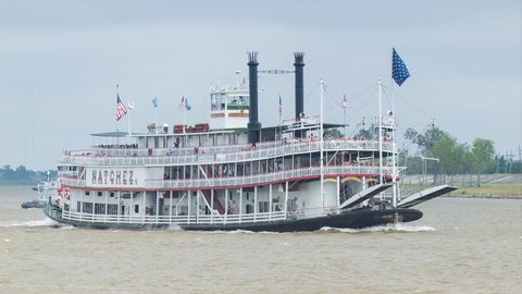 NEW ORLEANS - 2014: Steamboat Natchez Paddle-wheeler Scenic Cruising on the Mississippi River to the French Quarter in New Orleans Louisiana