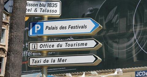 "Cannes, France - May 14, 2019: Street Signs With Directions of ""Luxury Hotel"", ""Palais des Festivals"", ""Office du Tourisme"", ""Taxi de la Mer"" on the Promenade De La Croisette in Cannes, France, French"