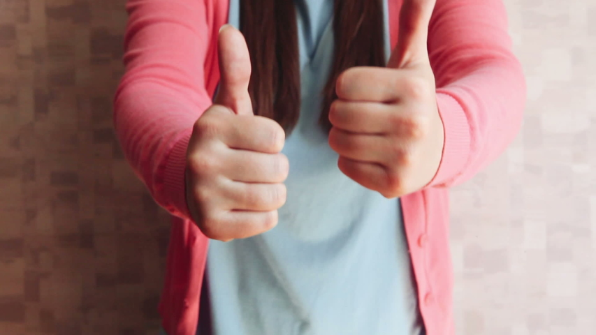 Beautiful woman show thumbs up, motivation and agreement concept