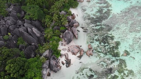 Aerial view of Anse Source d'Argent, La Digue, Seychelles shot in the early morning hours with no people on the beach.