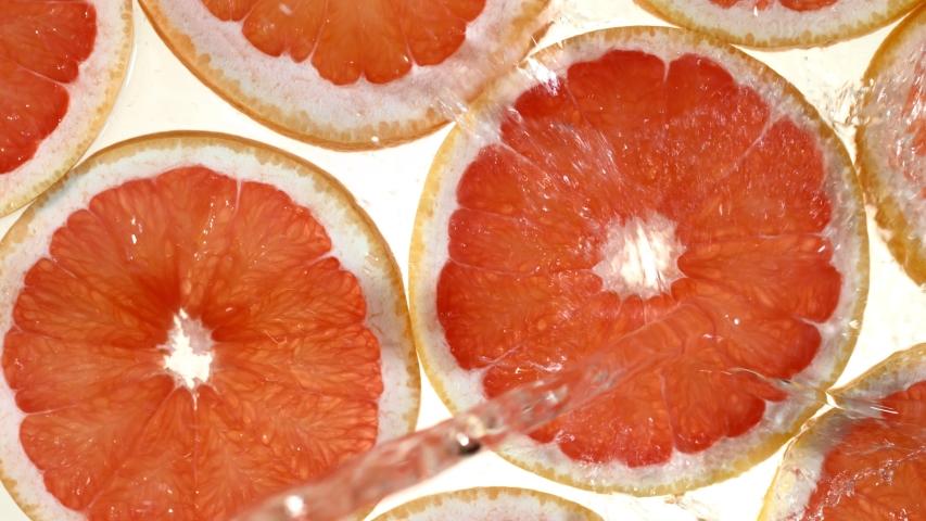 Super slow motion of grapefruit slices with water splash. Filmed on high speed cinema camera, 1000 fps. #1029769835