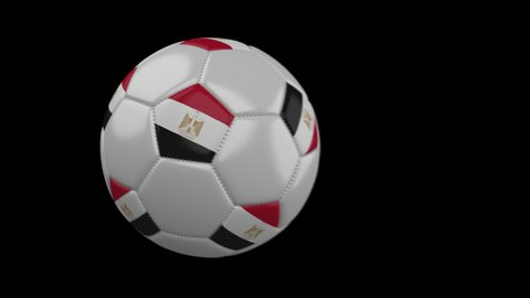 Soccer ball with flag Egypt flies past camera, slow motion blur, 4k footage with alpha channel