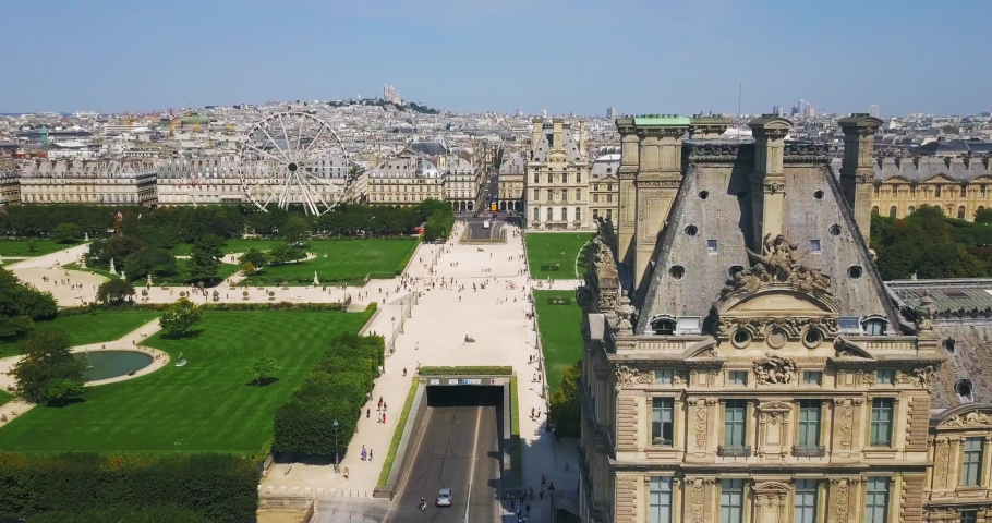 A beautiful view from the top of the walkway leading to the famous Louvre Museum, along the green alleys and visible rooftops of Paris, France | Shutterstock HD Video #1029831245