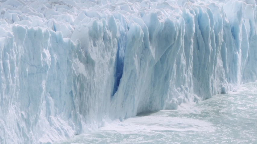 Chunk of glacier collapsing into the lake Argentino on the patagonian region. Slow motion.  | Shutterstock HD Video #1029864755