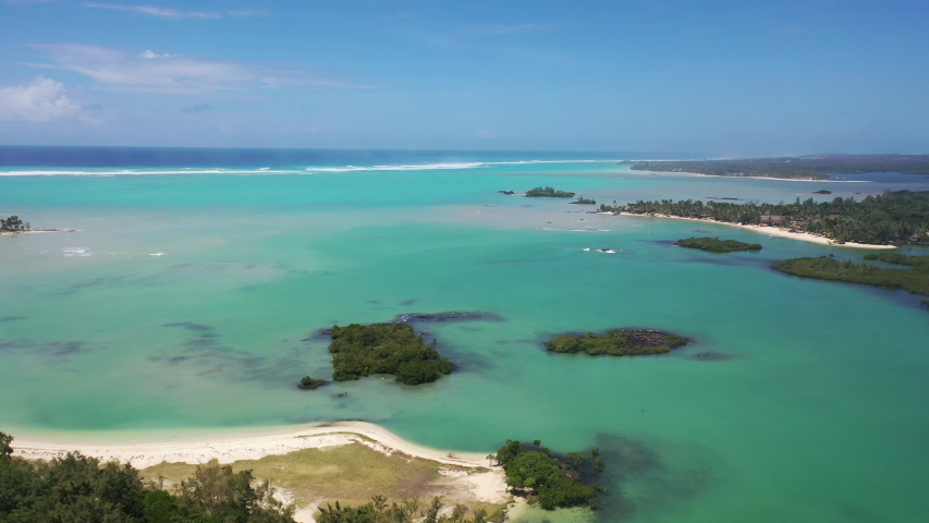 Aerial view of the white sand beaches and blue water tropical paradise of Anse La Raie, Mauritius | Shutterstock HD Video #1029866105
