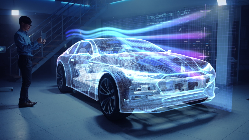Automotive Engineer Working on Electric Car Chassis Platform, Using Tablet Computer with Augmented Reality 3D Software. Vehicle Virtual Mesh Model is Tested in Digital Wind Tunnel. | Shutterstock HD Video #1029926645