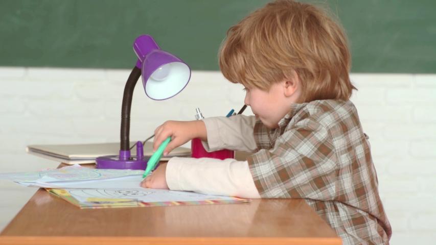 School kids against green chalkboard. Book school and kids. Preschooler. First school day. Happy mood smiling broadly in school   Shutterstock HD Video #1030042265