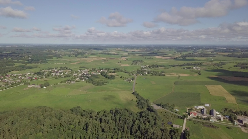Aerial of Lithuanian countryside and farmlands in Zemaitija National Park. Samogitia (Zemaitija, Zemaiteje) ethnographic region of Lithuania. | Shutterstock HD Video #1030084565