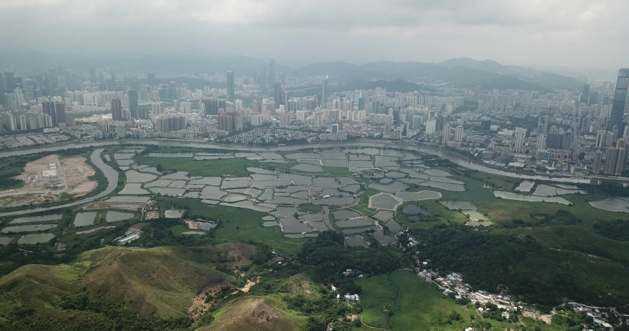 Aerial view of beautiful landscape near border of New Territories, Hong Kong. Well developed Shenzhen is in opposite side  | Shutterstock HD Video #1030104665