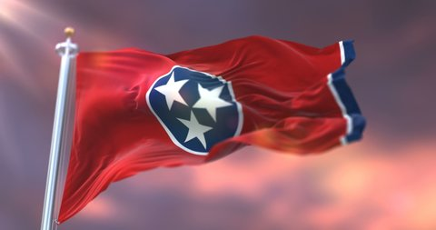 Flag of Tennessee state at sunset, region of the United States - loop