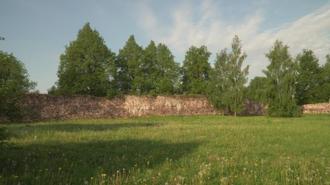 The territory of 13th century Livonia Order castle ruins in May of 2019.  The stone wall carcass of the ancient palace. Cultural monument of Latvia country. The region of Zemgale. Dobele old town.