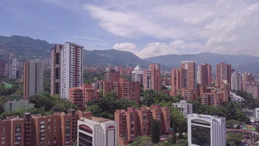 Beautiful tilting shot of Envigado and glorieta Aguacatala in Medellin, Colombia | Shutterstock HD Video #1030282565