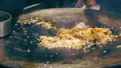 Video/footage of Chiken Biryani making on Tava.Famous dish of Ramadan/Ramzan and served in iftar.