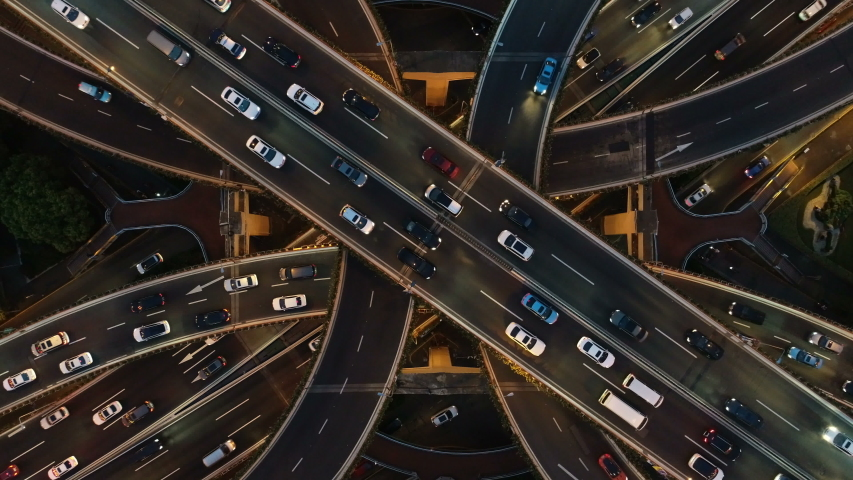 Overhead drone shot of cars driving over elevated highway and busy interchange in Shanghai, China #1030403975