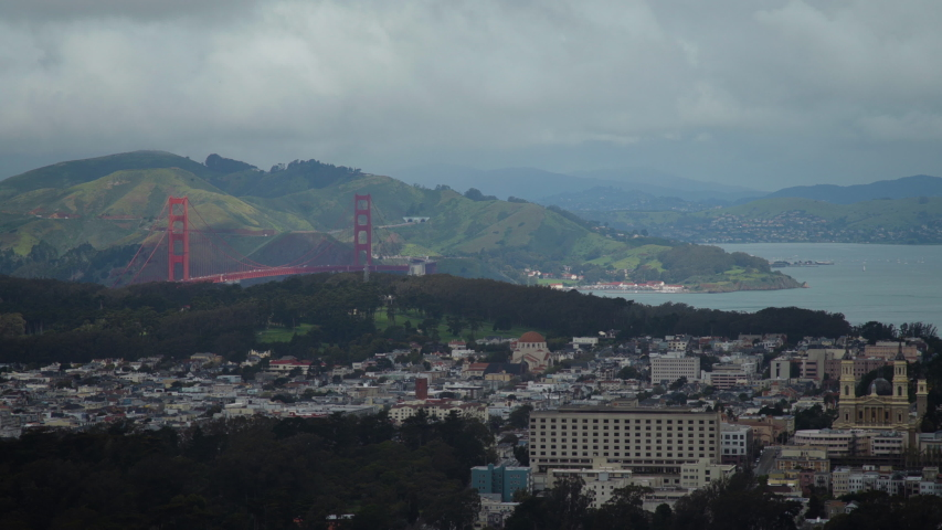 View of the cityscape of San Francisco, with the Golden Gate Bridge, on a cloudy, foggy day. Shot on a Canon C200 in 4K in San Francisco in 2019. | Shutterstock HD Video #1030407095