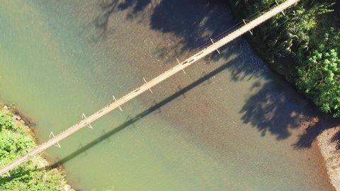 Iron and wood bridge over a river in Santa Cruz do Sul, Rio Grande do Sul, Brazil