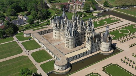 Aerial view of Chambord Castle (Chateau Chambord), picturesque castle in Loire Valley built in French Renaissance style, UNESCO world heritage site - landscape panorama of France from above, Europe