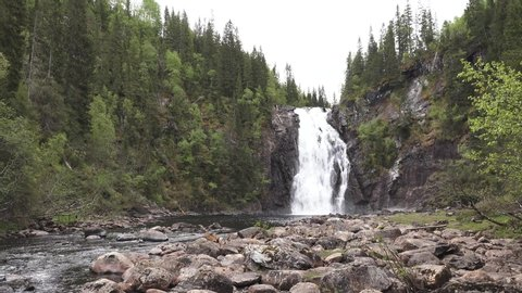 Video of the waterfall Storfossen in Malvik in the country of Norway, close to the city of Trondheim. Springtime with a lot of water.