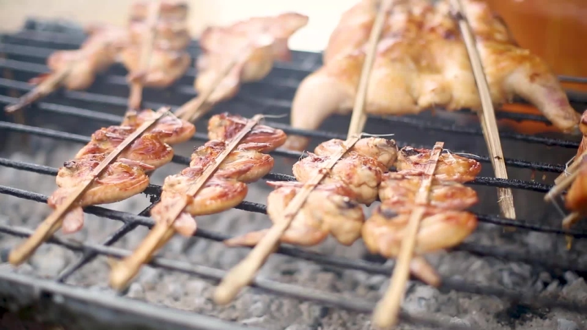 Thai grilled chicken with a lot of smoke,grilled