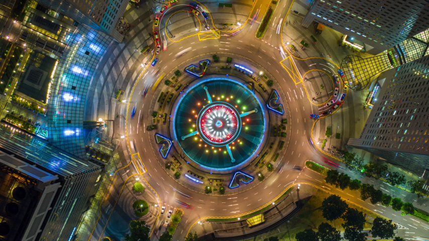 Hyperlapse or Dronelapse top view fly over the Singapore landmark financial business district with skyscraper. Fountain of Wealth at Suntec city in Singapore. Circle of traffic in center of business. | Shutterstock HD Video #1030739045