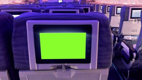 """Green Screen Monitor in the Aircraft Cabin. Zoom In. You can Replace Green Screen with the Footage or Picture you Want with """"Keying"""" Effect (check out tutorials on YouTube)."""