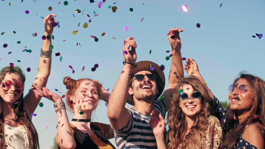 Group of friends dancing in confetti  | Shutterstock HD Video #1030935875