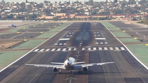 Back view of an airplane taking off in the Lindbergh Field in San Diego.