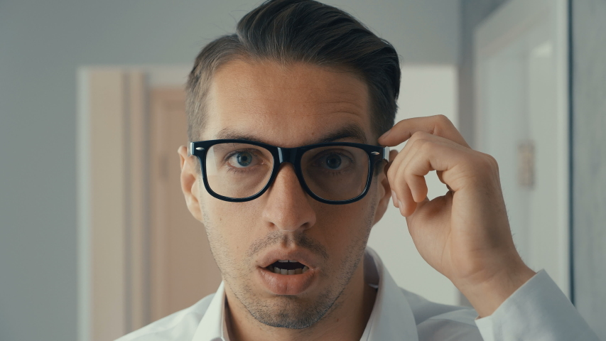 Businessman shocked and surprised. A man in surprise shoots glasses and looks at the camera in surprise. | Shutterstock HD Video #1030983155