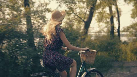 Cyclist. Bicycle Girl. Cycling.Girl Riding On Bicycle.Woman On Bicycle.Girl Cycling.Beautiful Girl Wearing Dress Rides On Bicycle.Woman Bike Riding.Cycling Female.Bicyclist Woman Retro Bike.Velo Woman