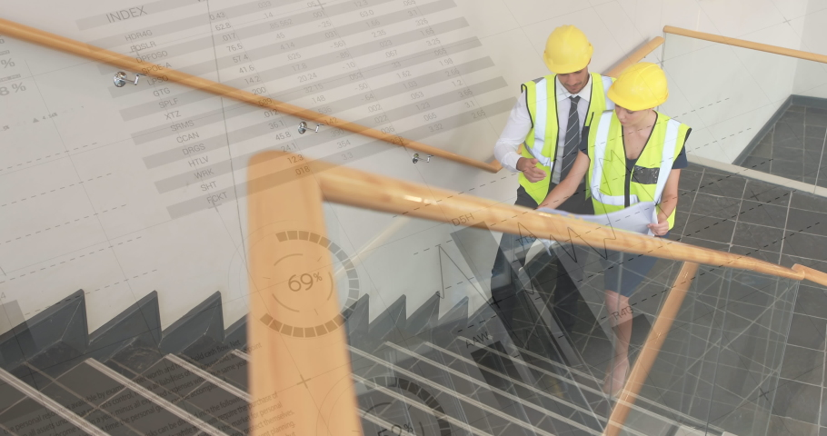 Digital composite of male and female Caucasian architects walking up the the stairs wearing safety construction gear with graphs and statistics in the foreground | Shutterstock HD Video #1031093285