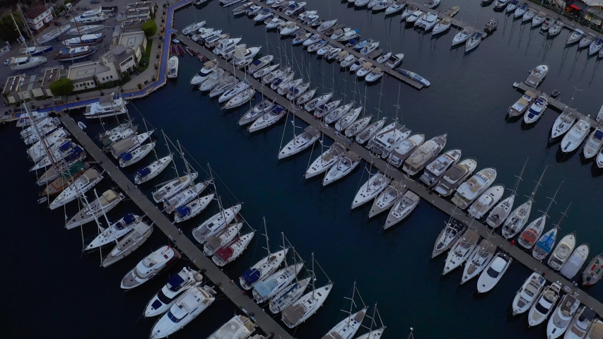 Fly over an elite yachts moored in the port eary in the morning. View from above 4k | Shutterstock HD Video #1031619635