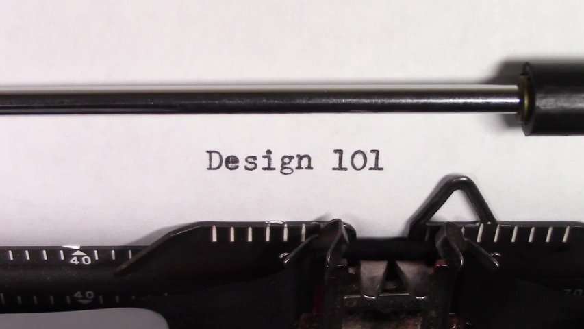 """A close up video of the words """"Design 101 """" being typed on white paper in an old manual typewriter. Shot in macro.   Shutterstock HD Video #1031830475"""