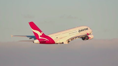 Sydney, Australia - May 31, 2019: Qantas Airbus A380 large passenger airliner taking off from Sydney airport at sunset.