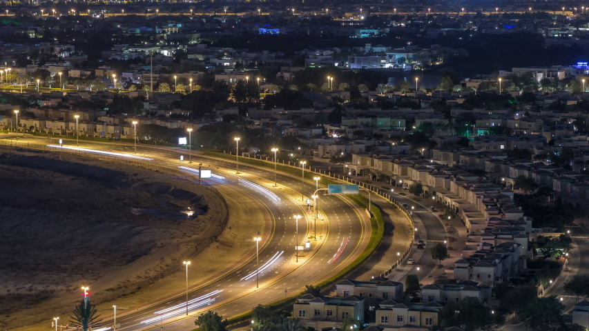 Aerial view to villas and houses with Golf course night timelapse. Traffic on intersection. Lakes with fountains | Shutterstock HD Video #1031914115