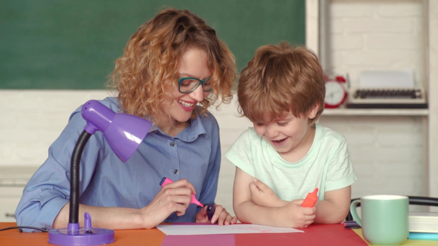 Learning and education concept. Young happy family mother and som schooling math together. Cute pupil and mother making schooling work. Nice family photo of little boy and his Parent   Shutterstock HD Video #1031974415